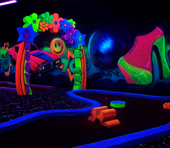 Enjoy black light mini-golf fun while listening to rock n' roll classics! Family 4 Pack for 50% OFF - JUST $20!